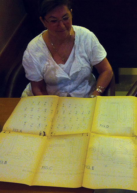 Camille Khattar Hedrick, daughter of Nasri Khattar, showing her father's work to Pascal Zoghbi in a café in Mansourieh, August 2012.